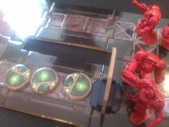 This was on the other side of the door - a 3, a 2 and a 2 Genestealer marker!