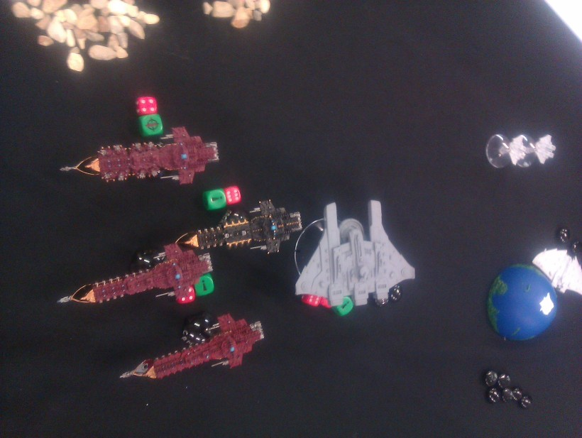 As the fleets glide past each other, the Tau Wardens finally manage to destroy the limping Gothic, while the Custodian cripples one of the Dominator squadron.